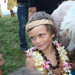 This writer's kindergarten graduate donning kukui nut and plumeria lei